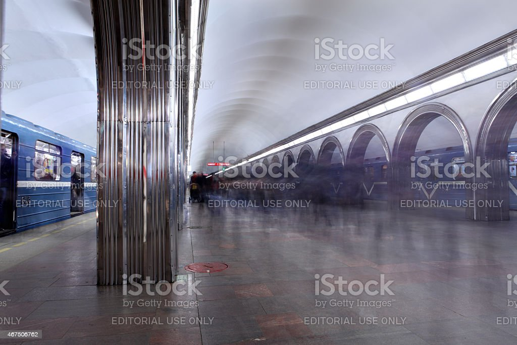Flow of passengers on platform metro station at rush hour. stock photo