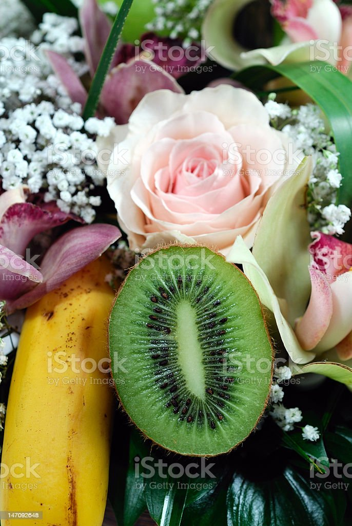 Flower and fruit arrangement stock photo