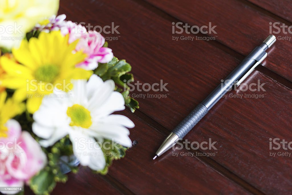 flower and pencil  on the table royalty-free stock photo