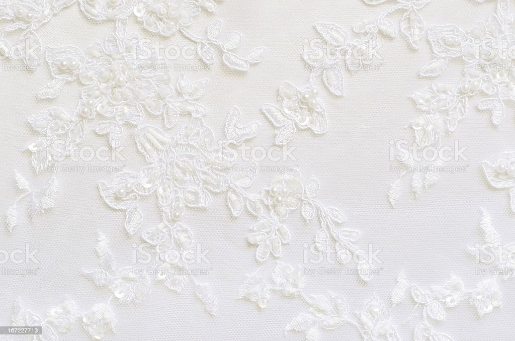 A flower and white lace with pearls stock photo