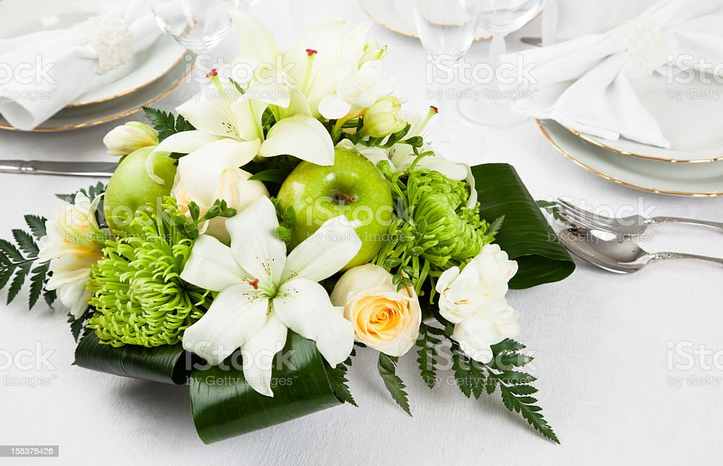 flower arrangement and table setting stock photo