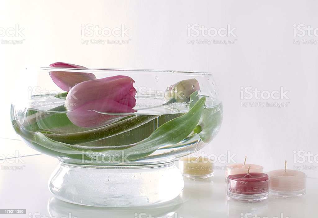 flower arrangement in a glass bowl with candles royalty-free stock photo