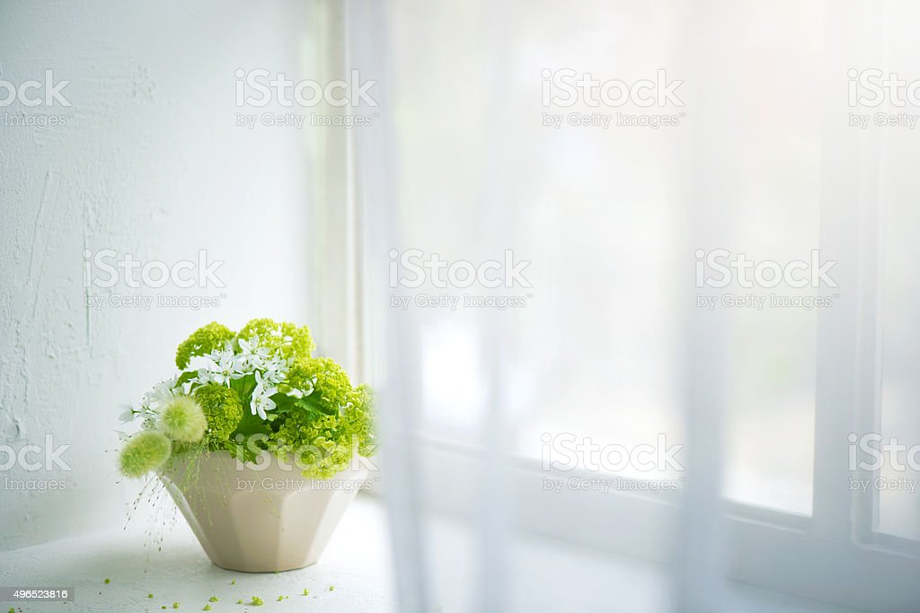 Flower arrangement of the window stock photo