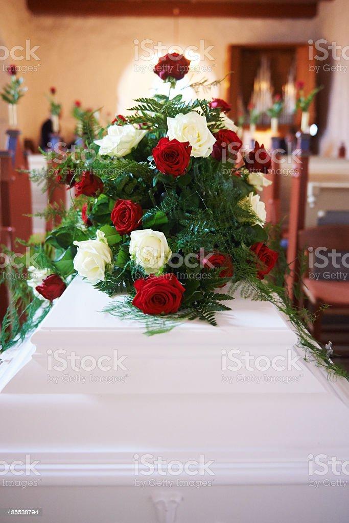 Flower arrangement on coffin stock photo