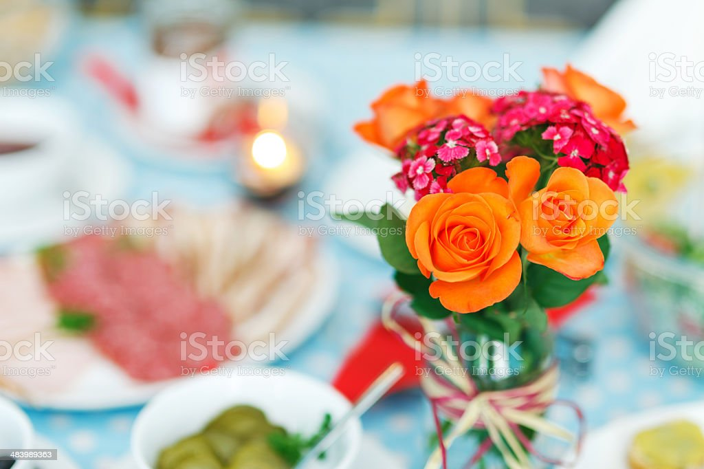 Flower arrangement on the diner table royalty-free stock photo