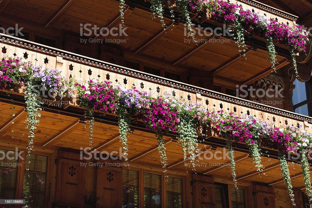 Flower Arrangements on Balcony of a Swiss Chalet stock photo