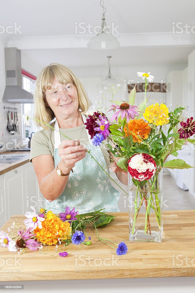 Flower Arranging In The Kitchen stock photo