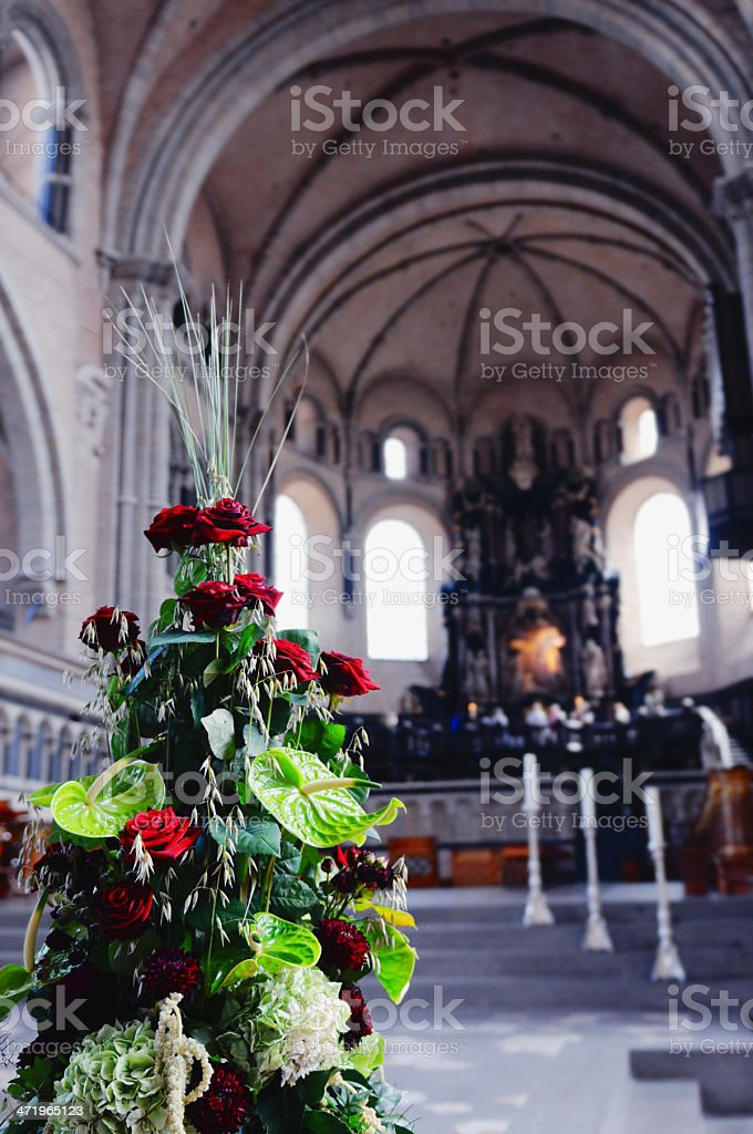 flower at altar Cathedral of Trier stock photo