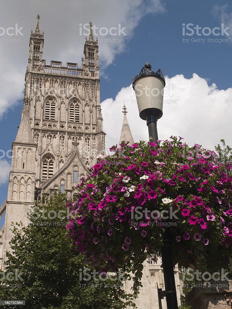 Flower basket on a streetlight outside Gloucester cathedral stock photo