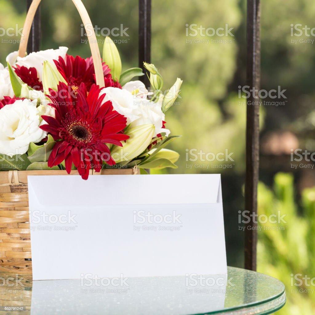 Flower basket with plain envelope stock photo