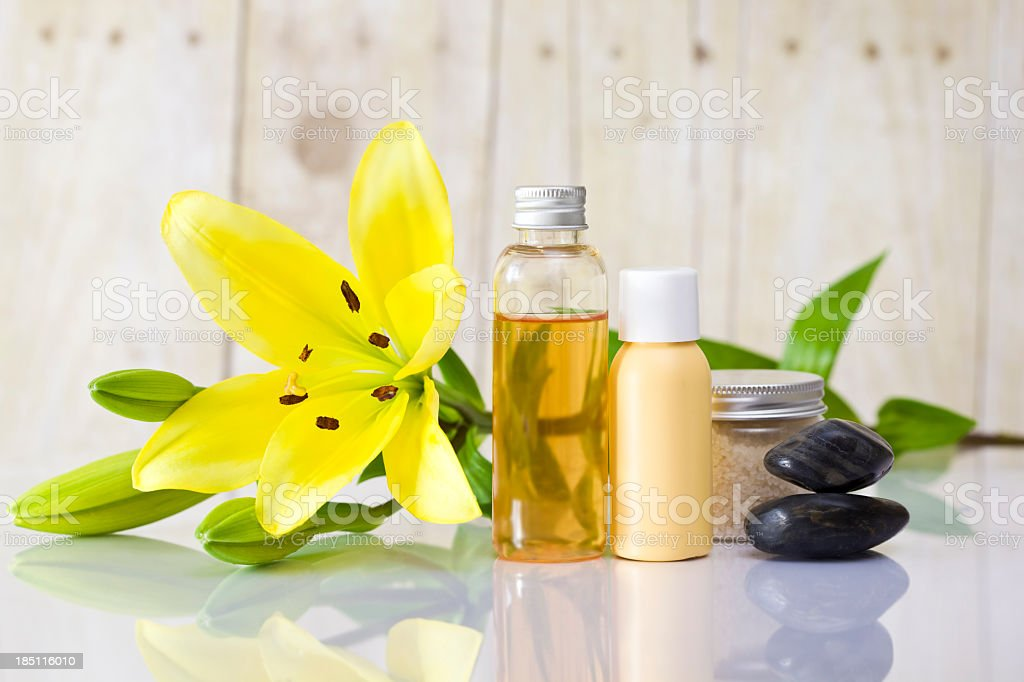 Flower blossom lying with spa and body care items stock photo