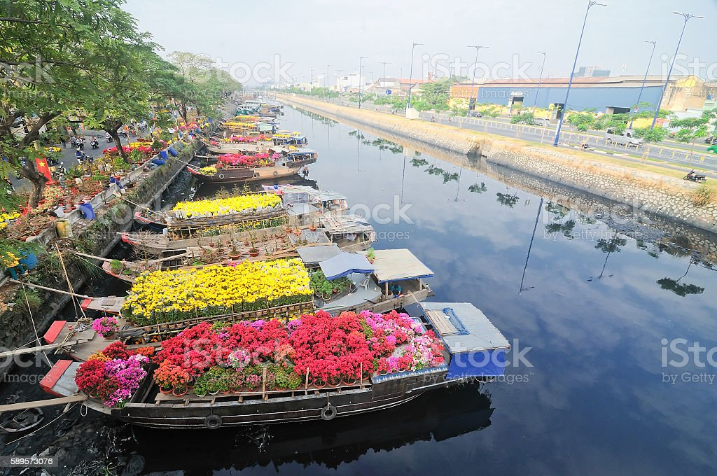 Flower boats along canal on New Year festival, HoChiMinh, Vietnam stock photo