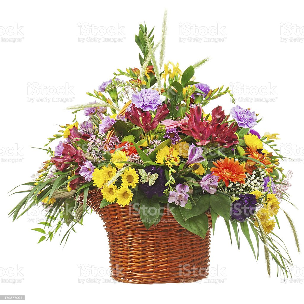 Flower bouquet arrangement centerpiece in wicker basket isolated royalty-free stock photo
