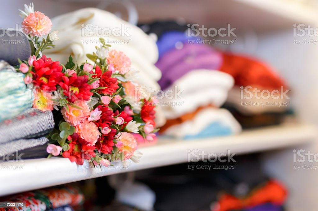 Flower Bouquet on Clothing Shelf stock photo