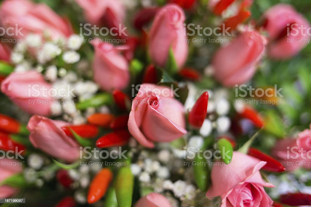 Flower bouquet - Pink roses and peppers royalty-free stock photo