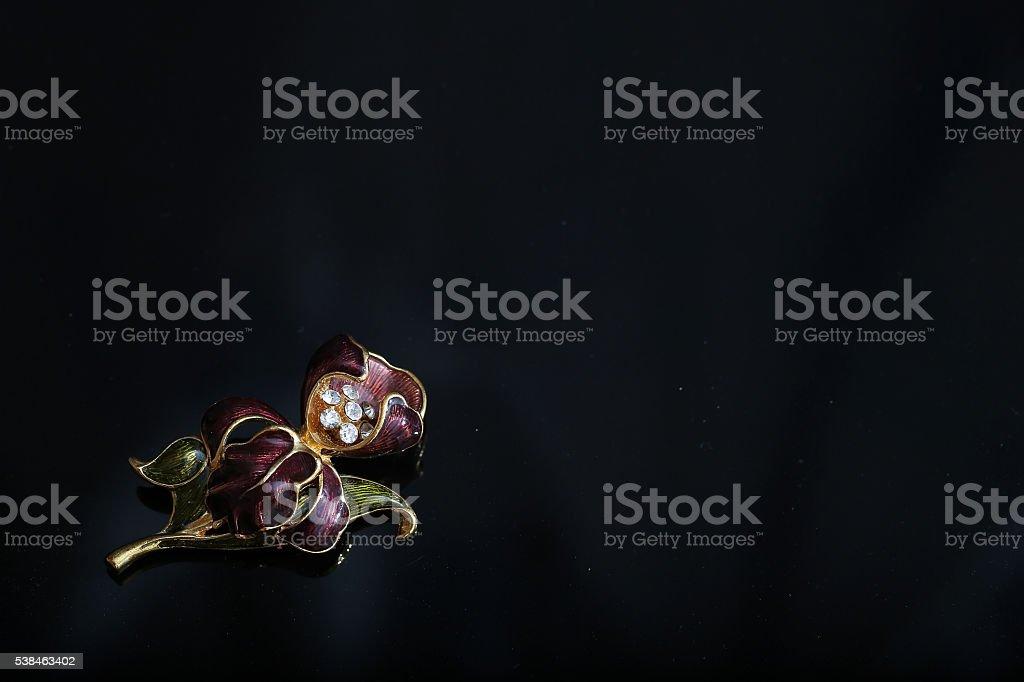 flower brooch stock photo