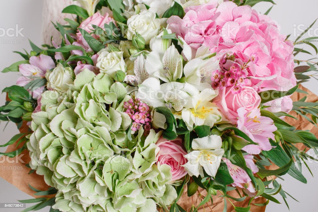 flower composition with hydrangea and roses. Color pink green. Kraft paper. crisp packaging stock photo