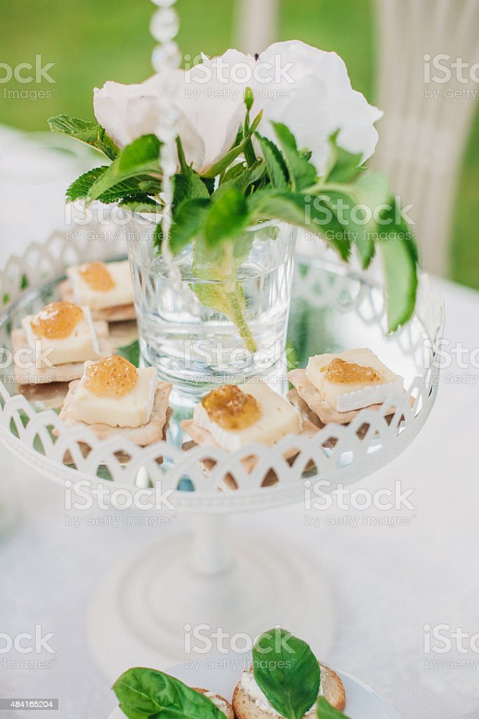 Flower decorated cake stand with Hors d'oeuvres stock photo