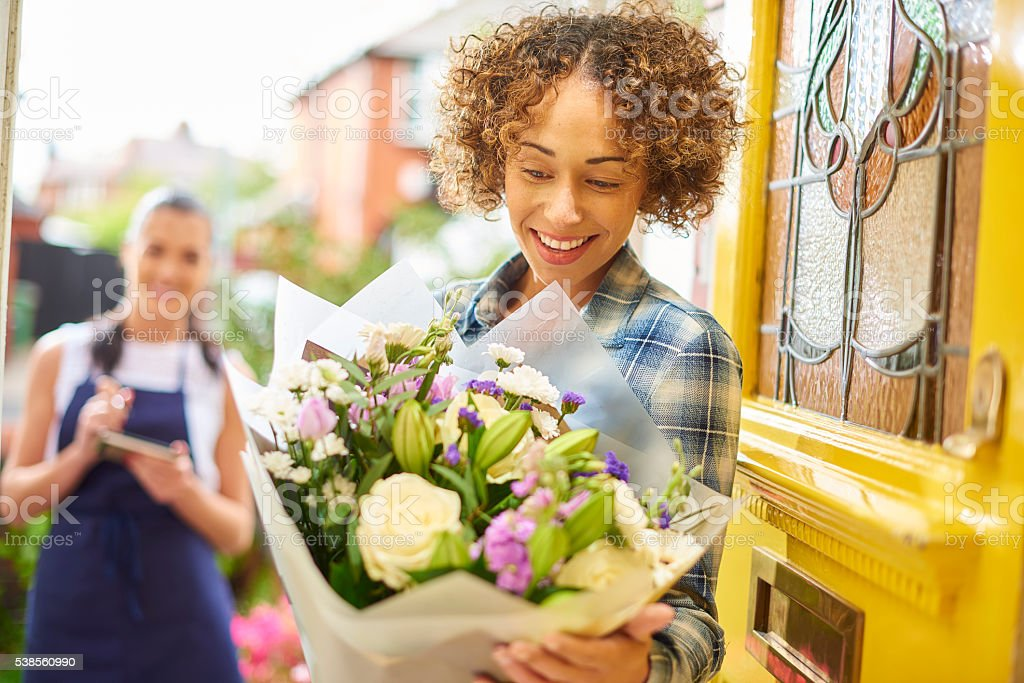 flower delivery girl makes her drop stock photo