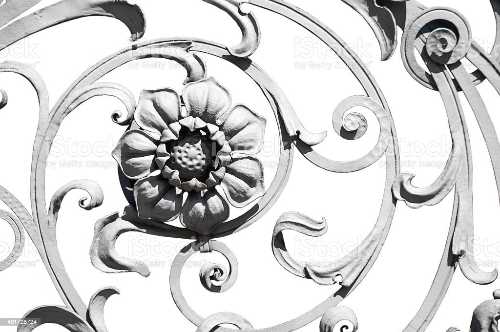 Flower detail of the old grey ornate fence stock photo