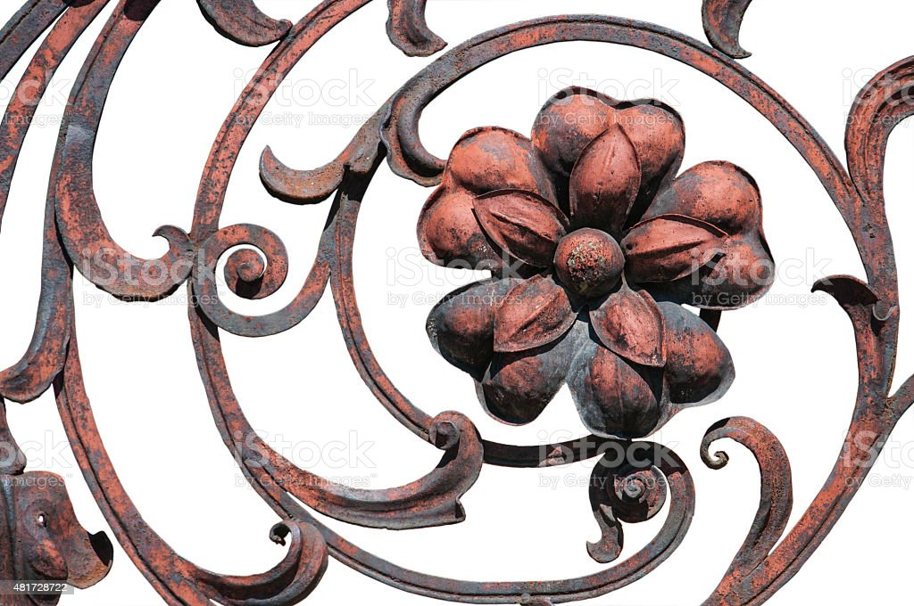 Flower detail of the old rust ornate fence stock photo