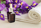 Flower essence dropper bottle,violet Iris, white terry towel wrap