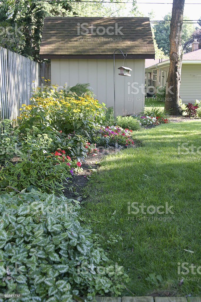 Flower garden with shed royalty-free stock photo