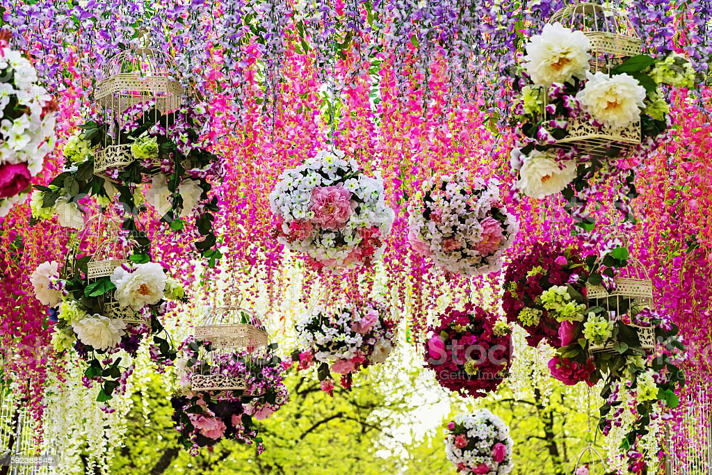 Flower garlands of multi-colored roses and wisteria. stock photo