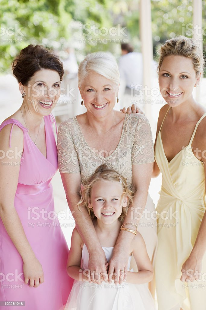 Flower girl and bridal party smiling stock photo