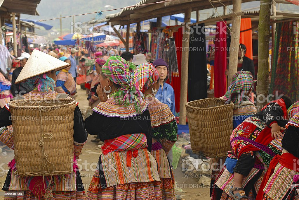 Flower Hmong woman in traditional dress at the market, Vietnam royalty-free stock photo
