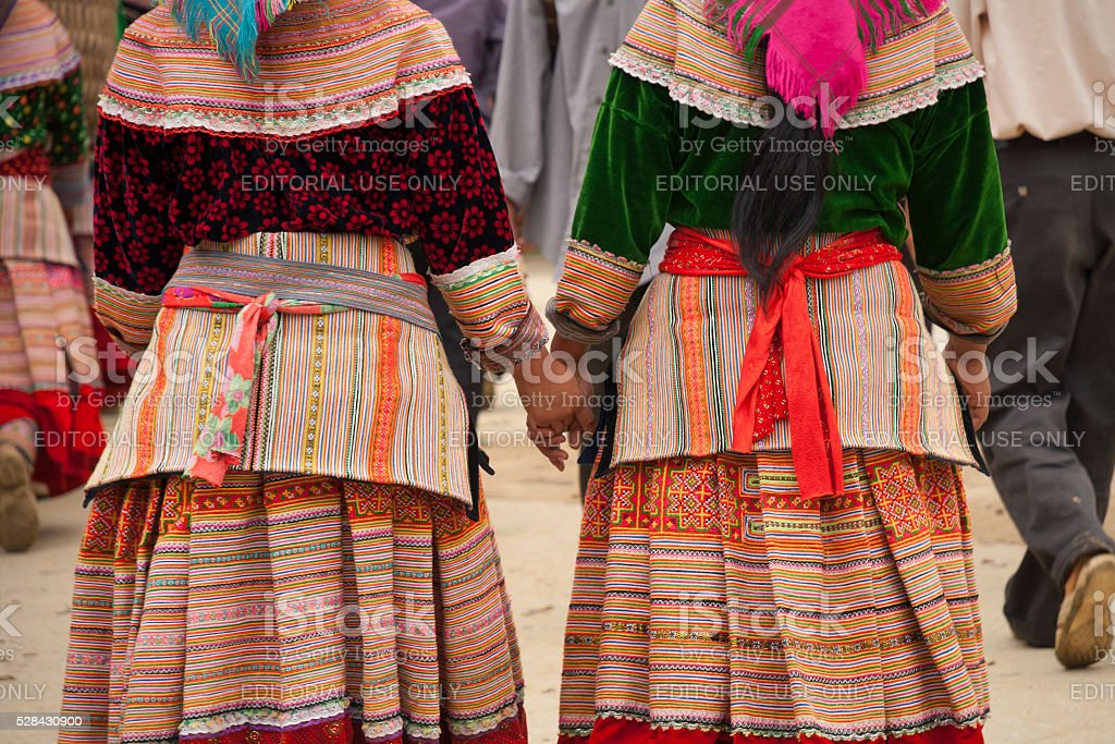 Flower Hmong women holding hands stock photo