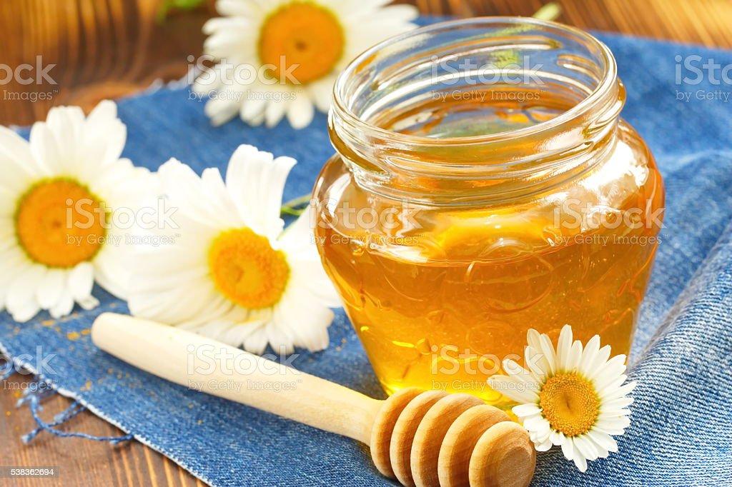 Flower honey in glass jar stock photo
