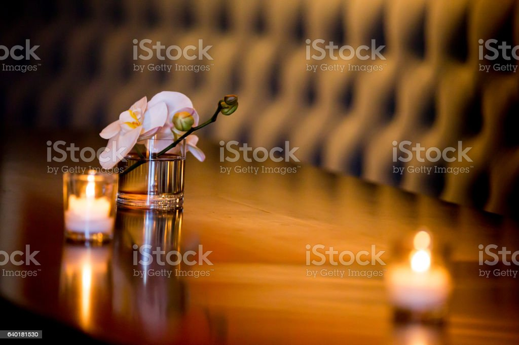 Flower in a Glass with Candle stock photo