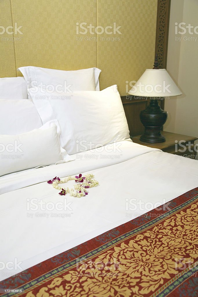 Flower Lei On Bed royalty-free stock photo