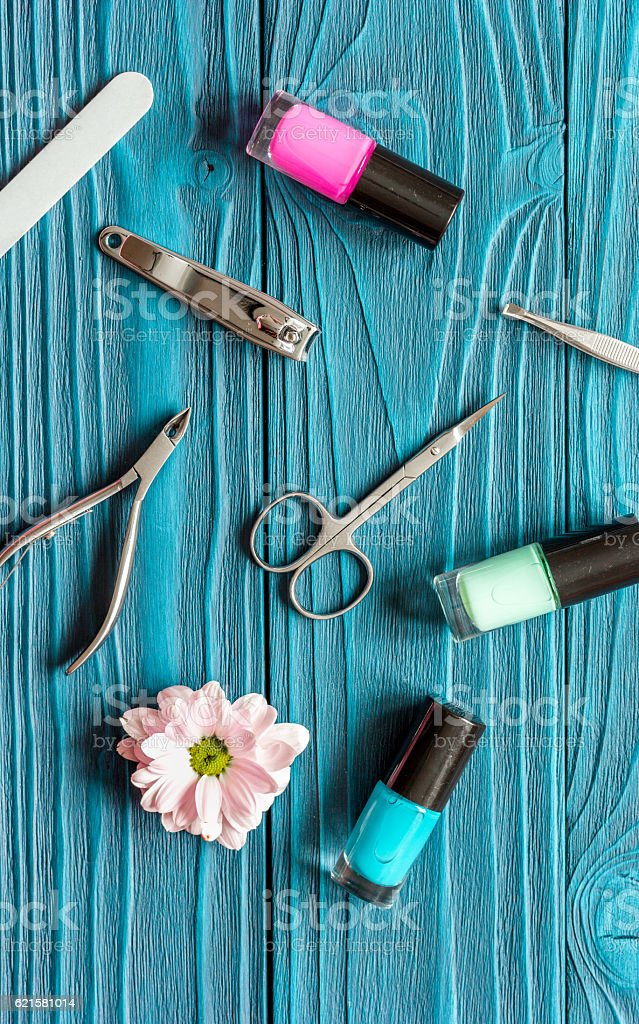 flower, nail polish and manicure set on dark wooden background stock photo
