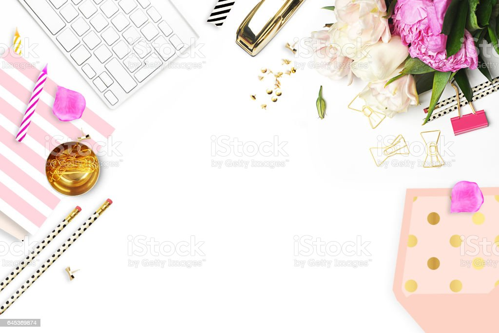 Flower on the table. Keyboard and stapler. Home workplace. Table view. Business accessories. Mock-up background.Peonies stock photo