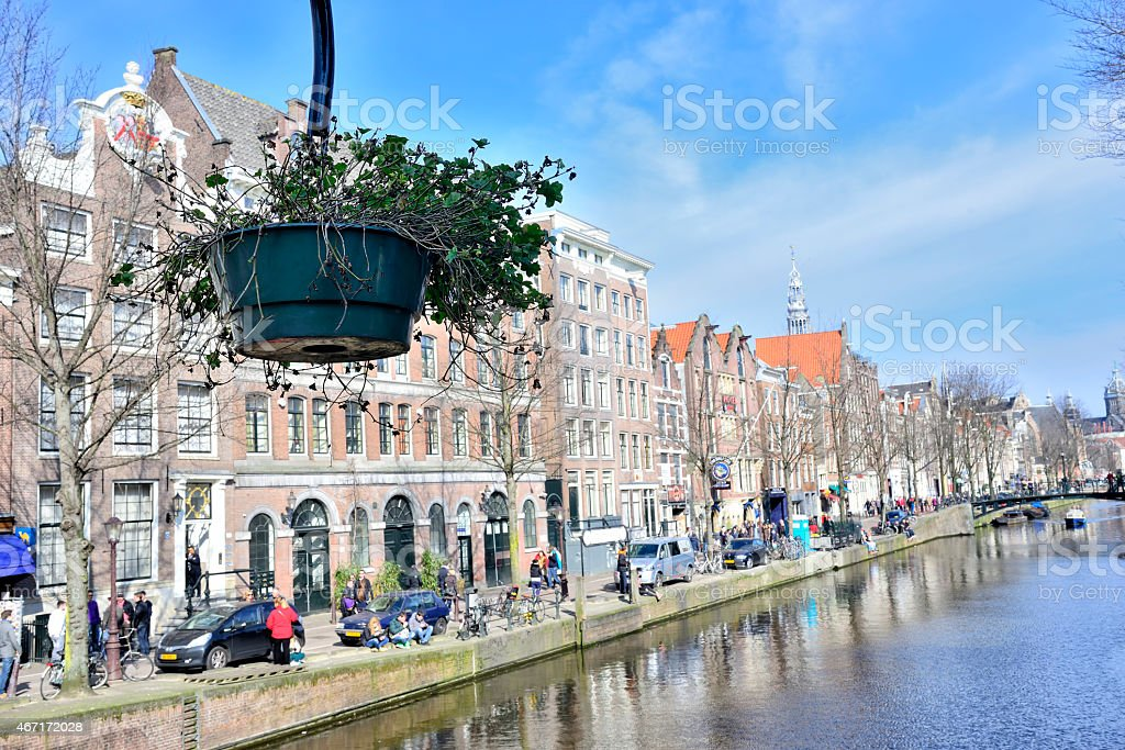 Flower pot over canal in Amsterdam stock photo