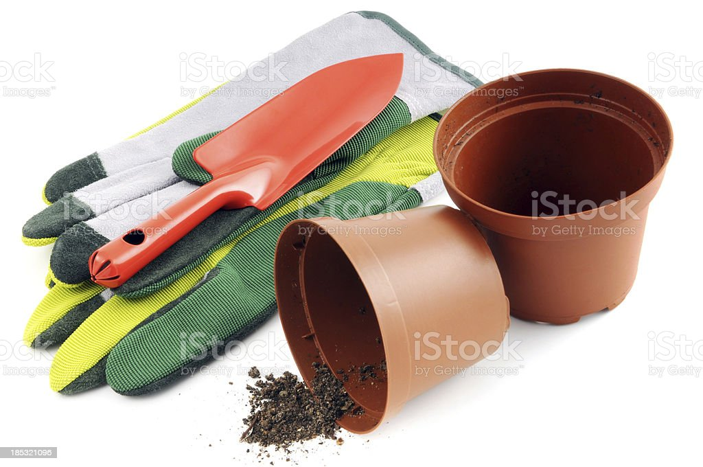 Flower pot with soil background of Gardening trowel Gloves stock photo