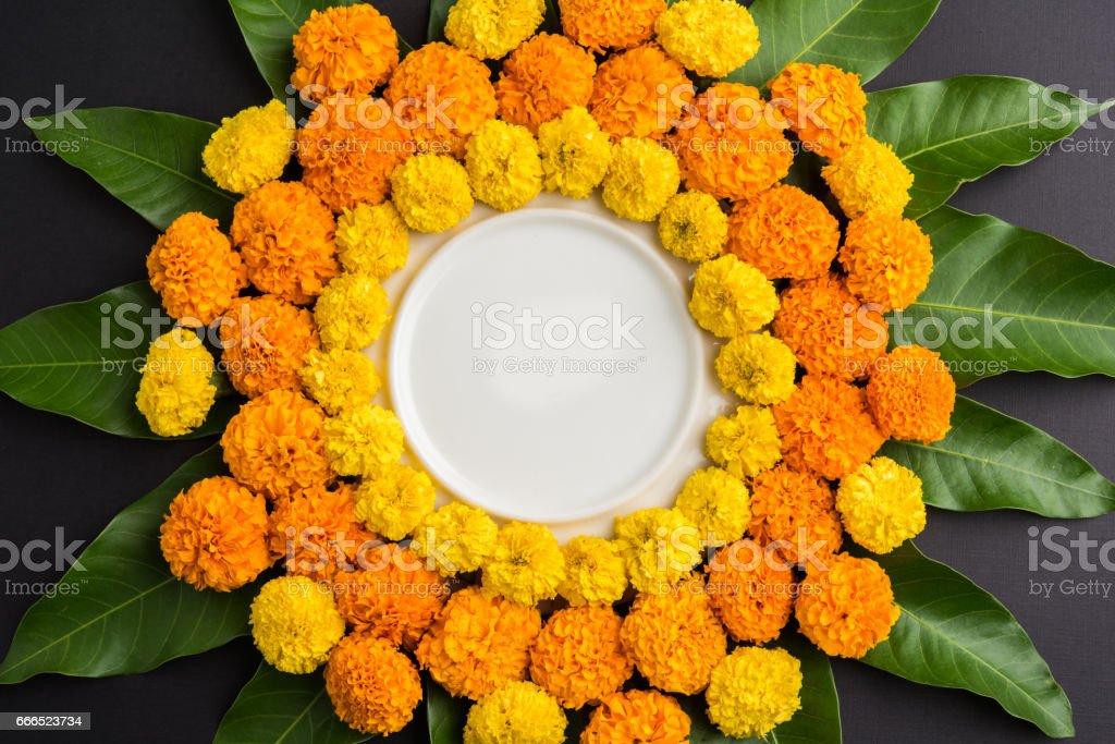 flower rangoli made using marigold or zendu flowers and