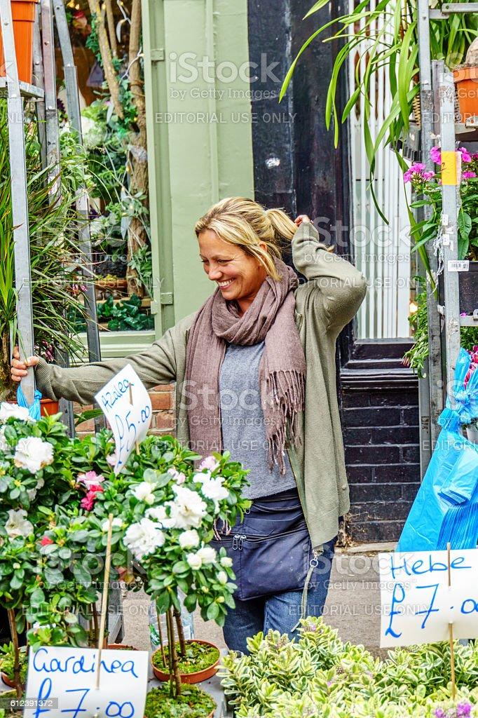Flower seller at London street market stock photo