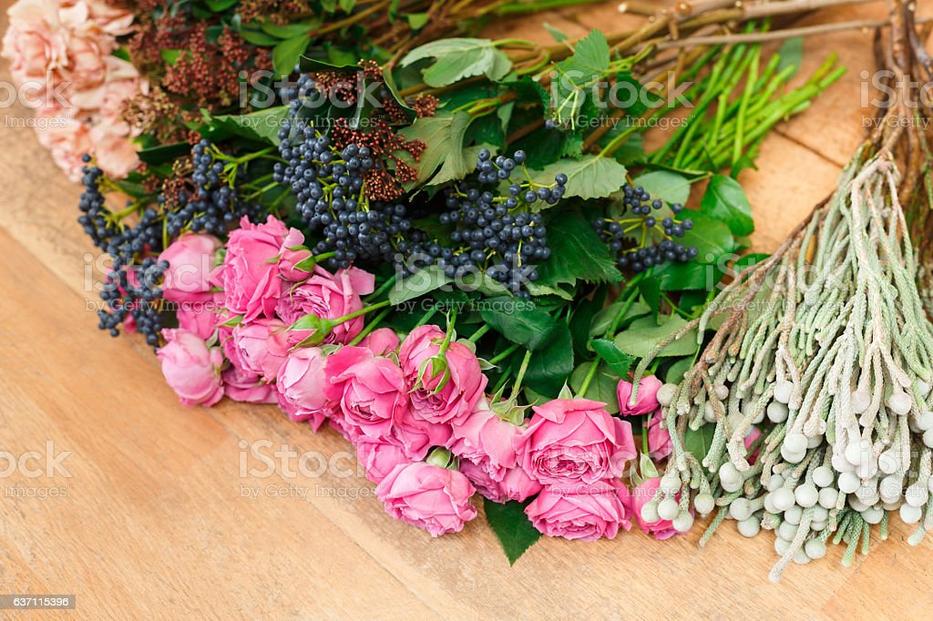 Flower shop background. Fresh roses for bouquet delivery stock photo