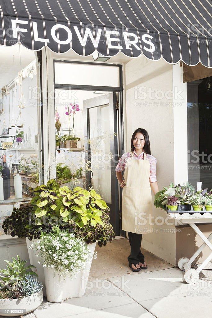 Flower Shop Business Owner Entrepreneur in Front of Store Vt royalty-free stock photo