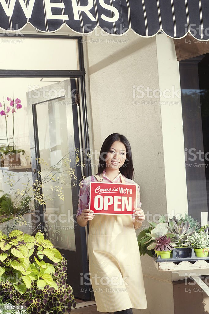 Flower Shop Retail Business Owner with OPEN Sign Vt royalty-free stock photo