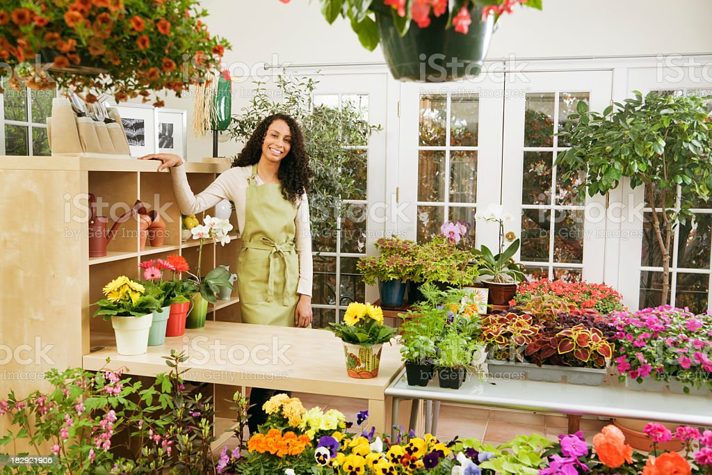 Flower Shop Store, with African Ethnic Small Business Owner Florist stock photo