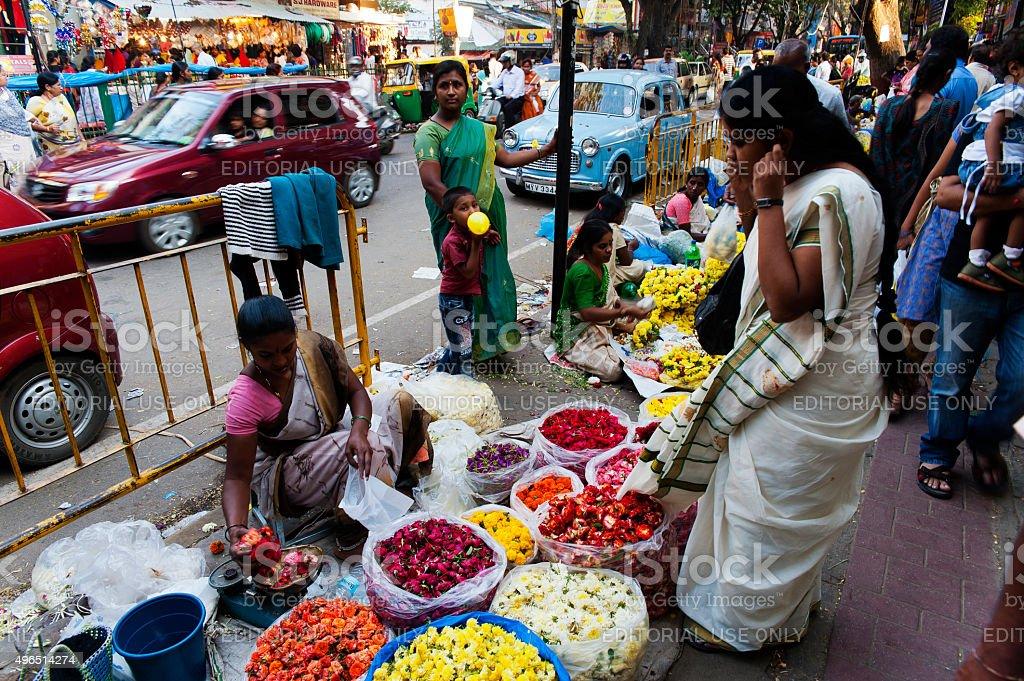 Flower street sellers at Bangalore town, Karnataka, India stock photo