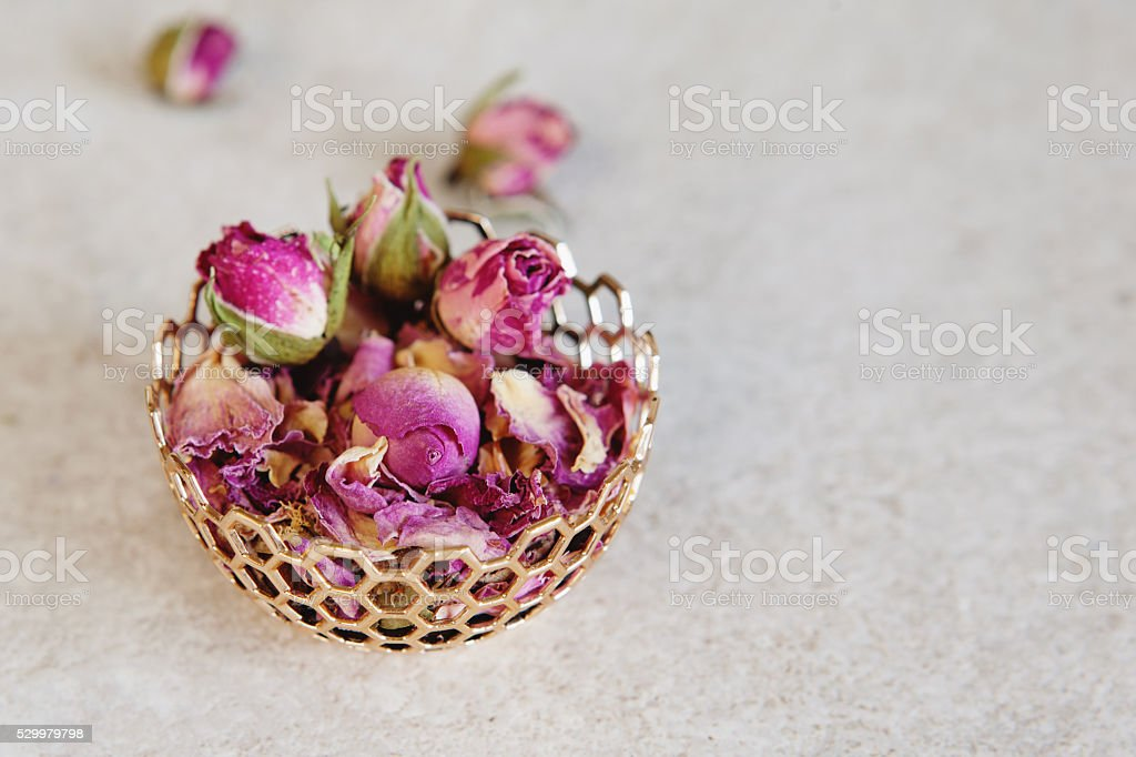 Flower tea rose buds on grey table stock photo