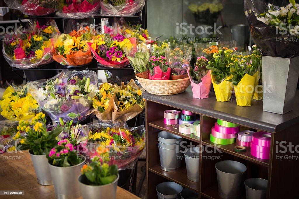 Flower vase arranged on a wooden worktop stock photo