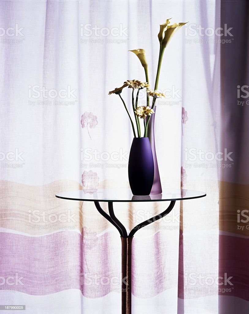 Flower vases on side table royalty-free stock photo