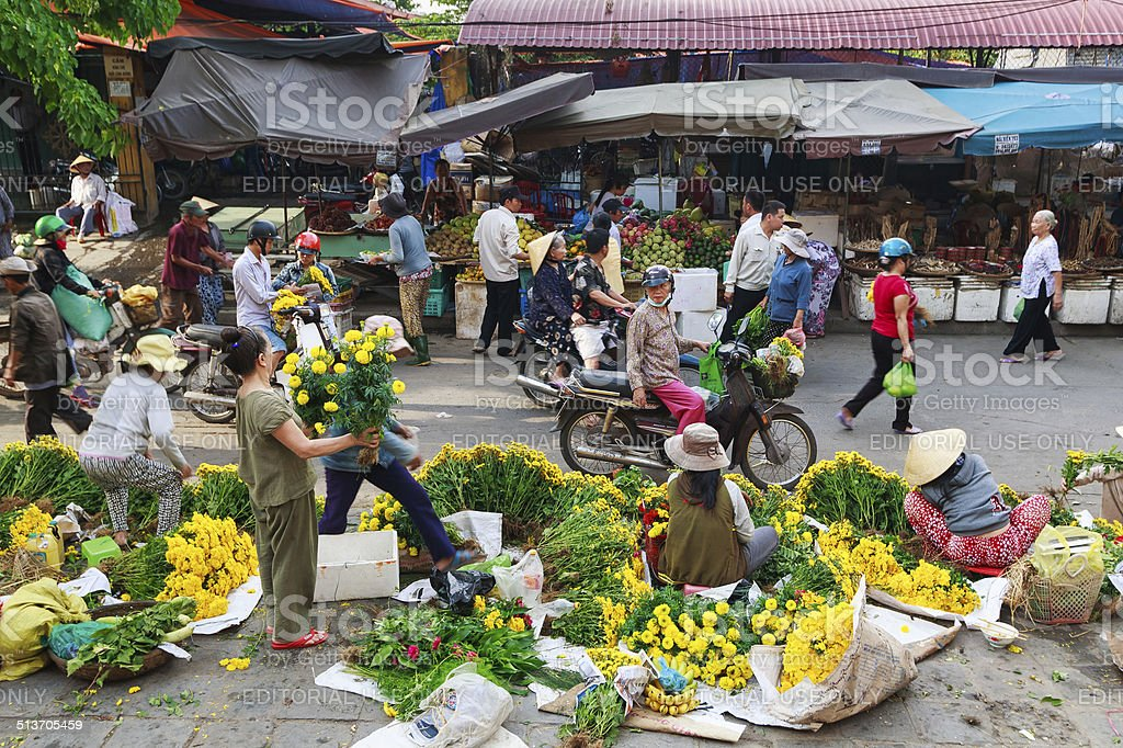 Flower vendors and fruit vendors at Hoi An market, Vietnam stock photo