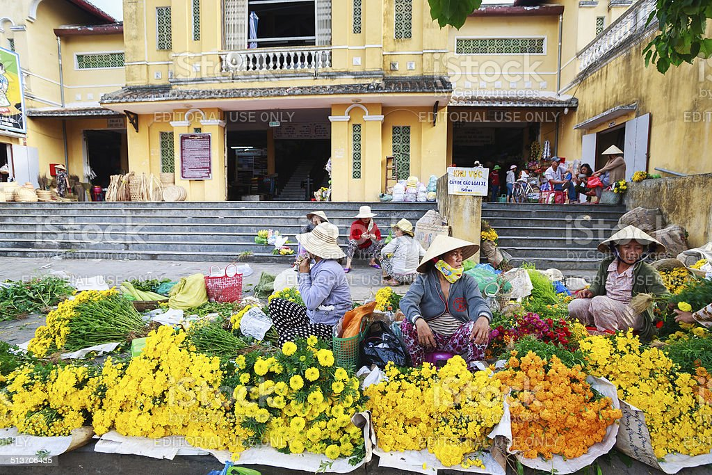 Flower vendors at the Hoi An market, Quang Nam, Vietam stock photo